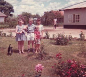 My sister, Cathy, me, Clement Barratt, my brother Anthony in front and the dog Titch - in front of the pise house