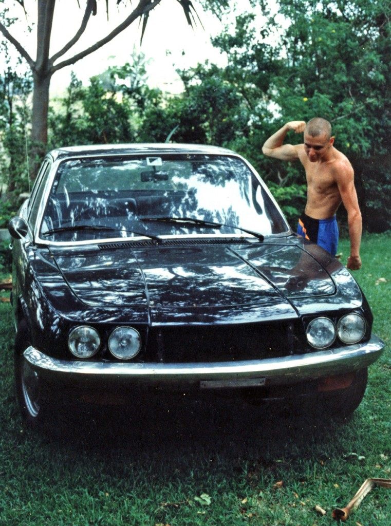 Paul flexing his muscles next to the 1970 NSU